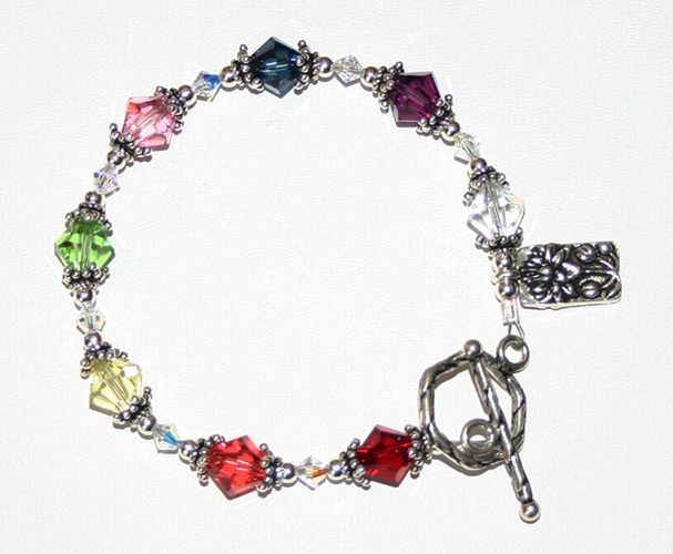 example shows Chakra Bracelet with Swarovski Crystal and Sterling Silver findings, one of Janet's homemade pieces of jewelry